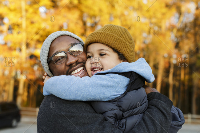 Father and son hugging in park