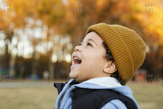 Mixed Race boy laughing in park