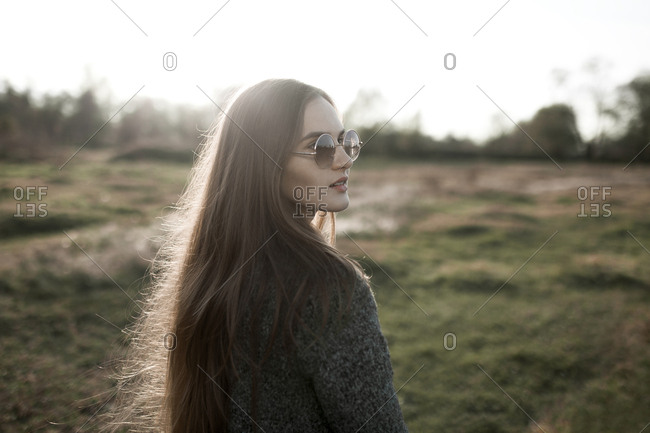 Caucasian woman wearing sunglasses in field