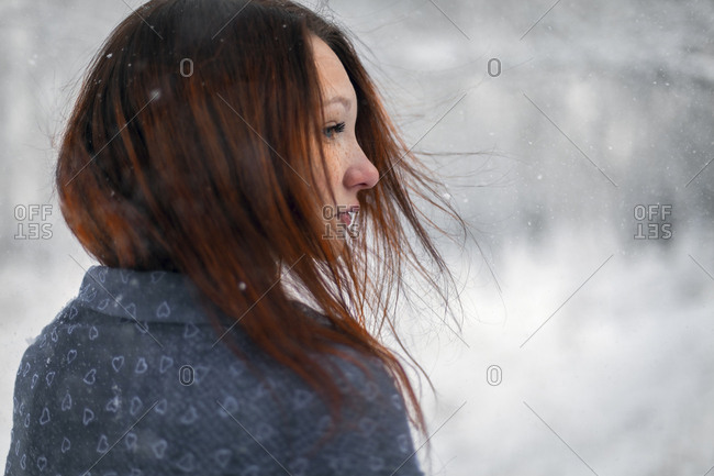 Hair of Caucasian woman blowing in wind in winter