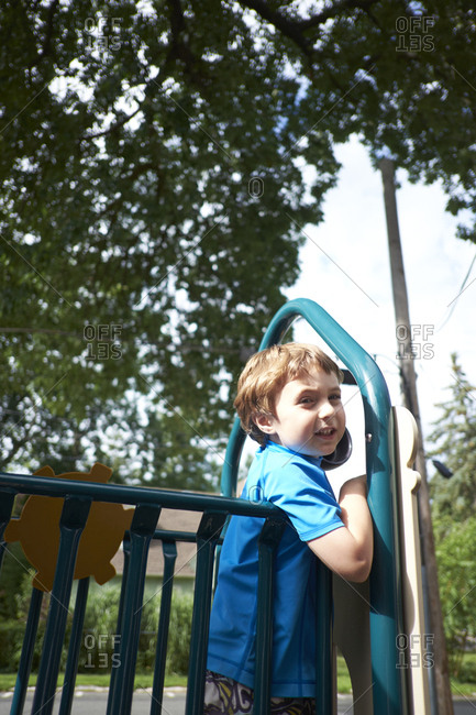 Boy at top of playground structure