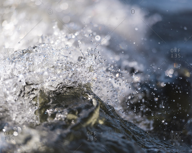 Detail of water drops from swiftly flowing water in the Potomac River in Maryland