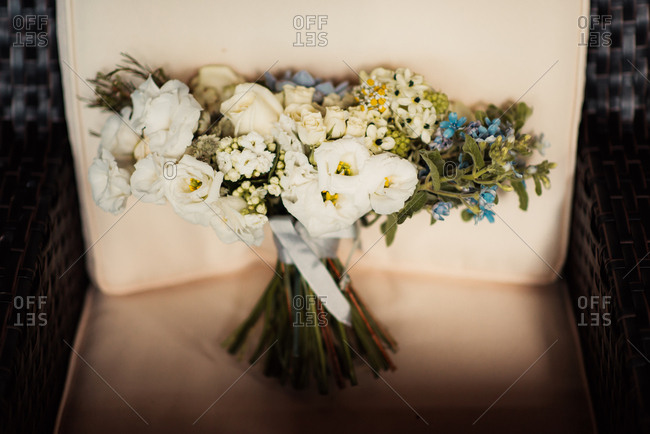 Bridal bouquet on a wicker chair