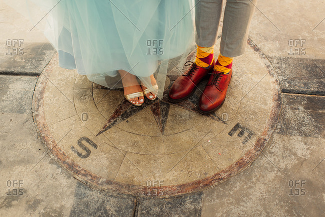 Stylish shoes on the feet of bride and groom
