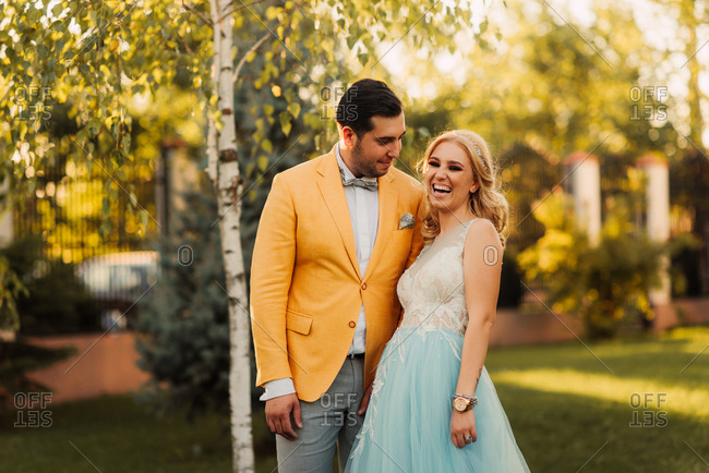 Portrait of bride and groom standing together in a park