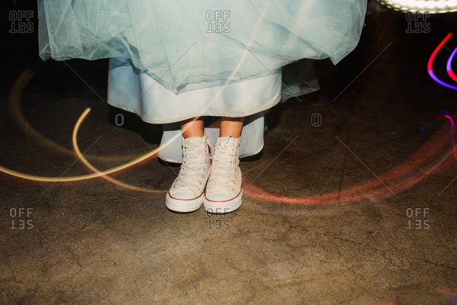 Bride in sneakers with colorful light trails