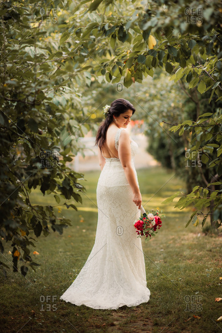Portrait of a bride holding bouquet and looking away