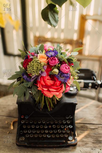 Bridal bouquet on an antique typewriter