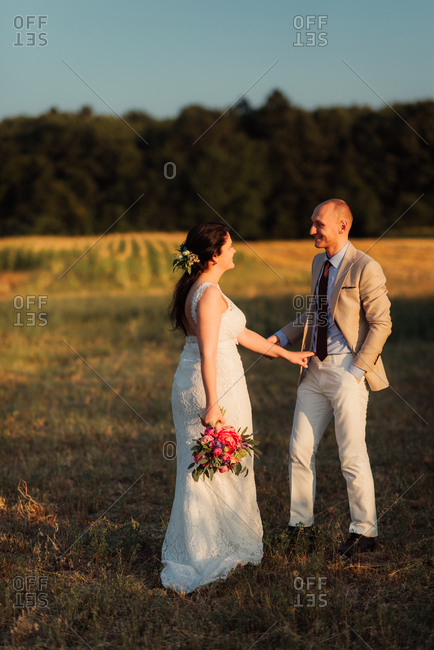 Bride and groom in a country field