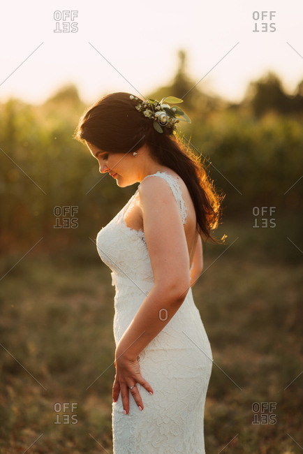 Portrait of a bride in a country field at sunset