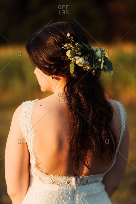 Rear view of a bride in a country field at sunset