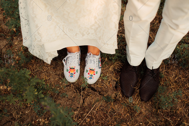 High angle view of shoes on bride and groom's feet