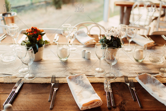 Tables with burlap table runner at an outdoor wedding reception