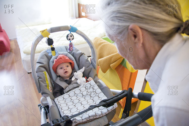 Baby boy with Grandmother in car seat