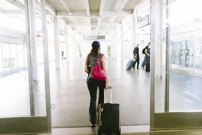 Female walks through San Francisco International Airport