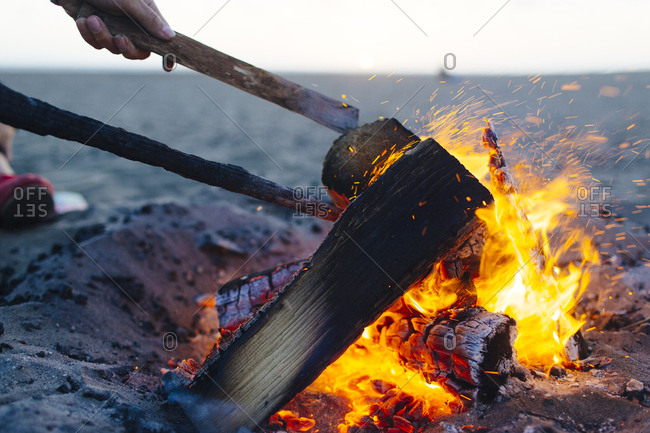 Girls get beach bonfire started in San Francisco, California