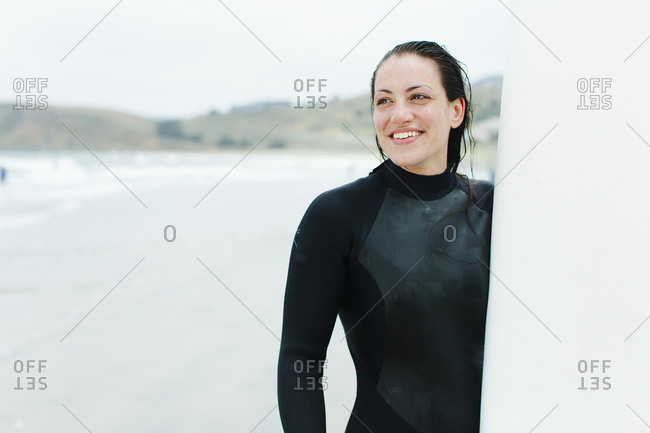 Female laughs at surf lesson in San Francisco, California