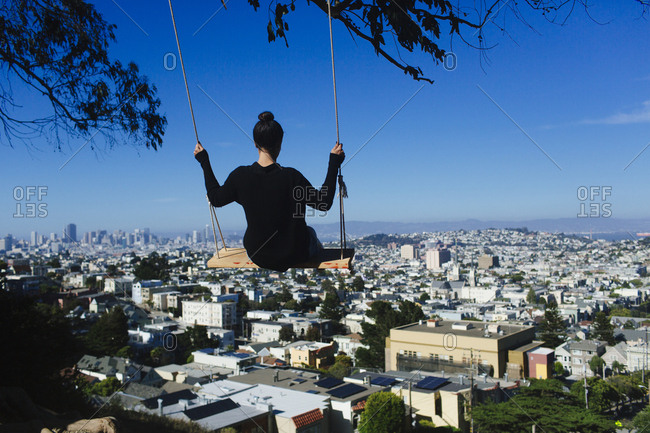 Woman swings over San Francisco, California