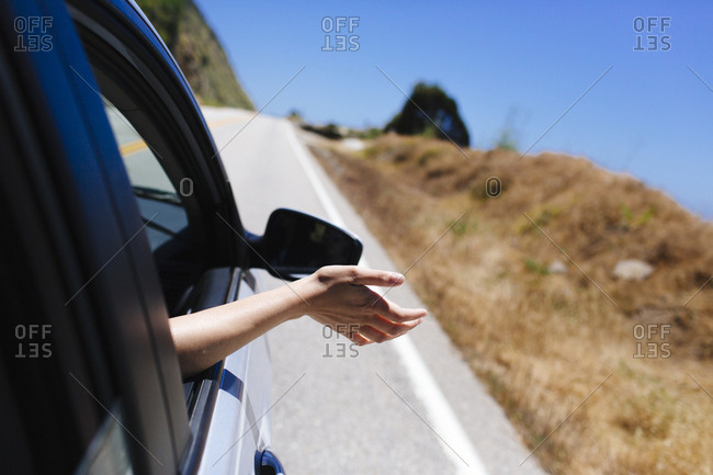 Female feels the wind on a drive down the Pacific Coast Highway, California