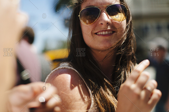 Female laughs with friend while walking in Hollywood, California
