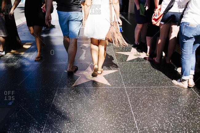 Hollywood, California, USA - June 20, 2015: People walk in Hollywood, California