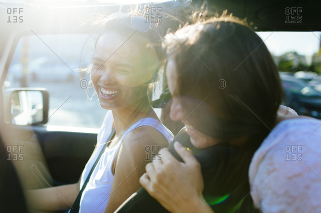 Females laugh together in open top jeep on California road trip