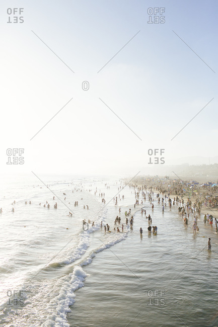 Santa Monica, California, USA - June 20, 2015: Beachgoers at sunset in Santa Monica Pier, California