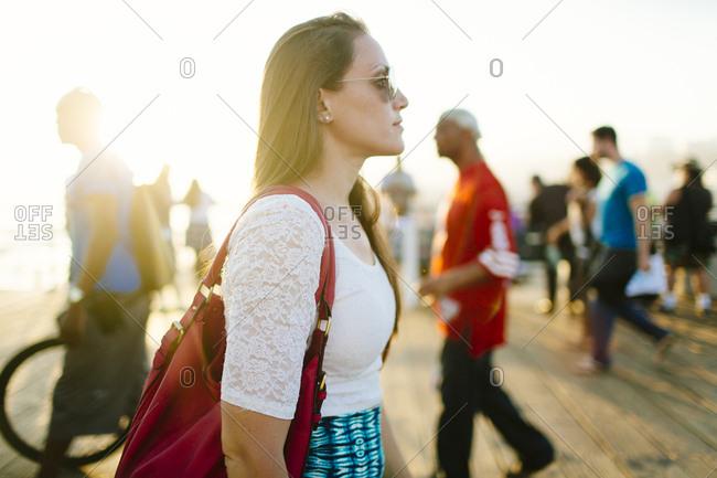 Female walks at Pacific Park in Santa Monica Pier, Santa Monica, California