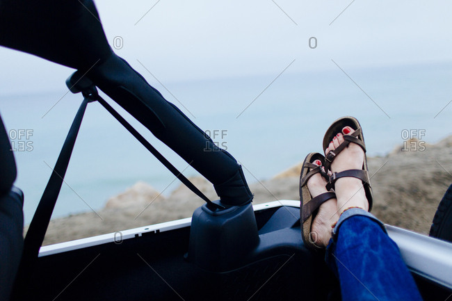 Female relaxes in Jeep on the Pacific Coast Highway, California