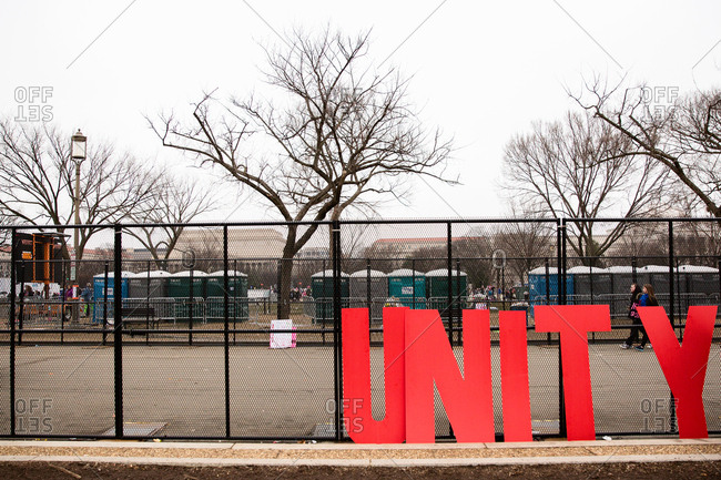 January 21, 2017: Unity sign leaned up against fence for peaceful protest for women's and LGBTQ rights