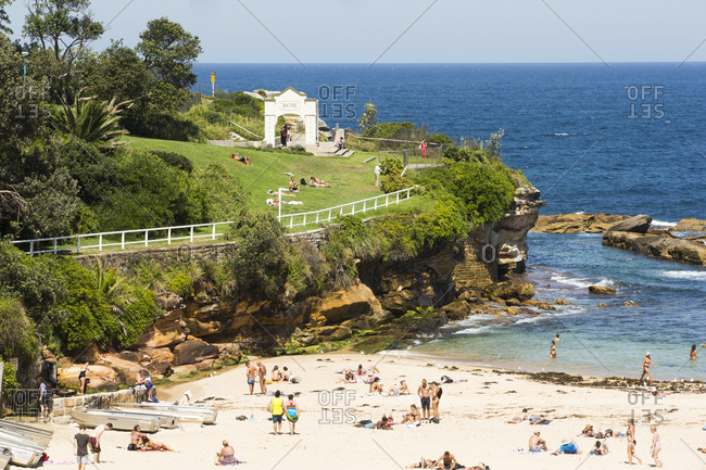 Sydney, Australia - February 24, 2017: Many people walking along Coogee Beach