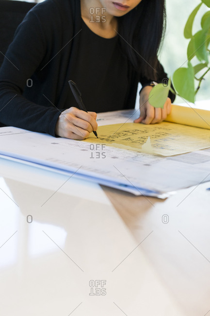 Architect tracing an architectural plan