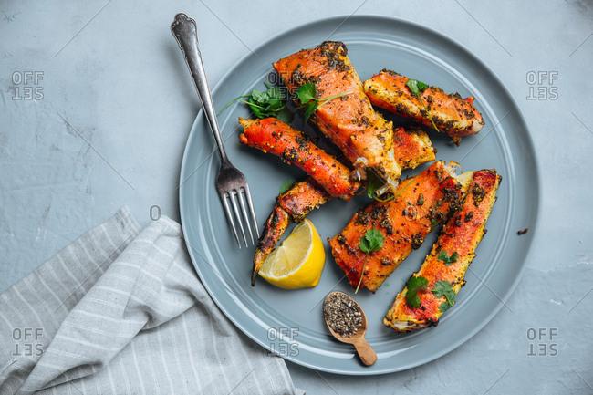 Plate of seasoned fish and crab legs