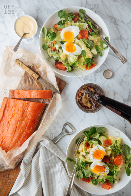 Overhead view of smoked salmon with soft boiled egg salads