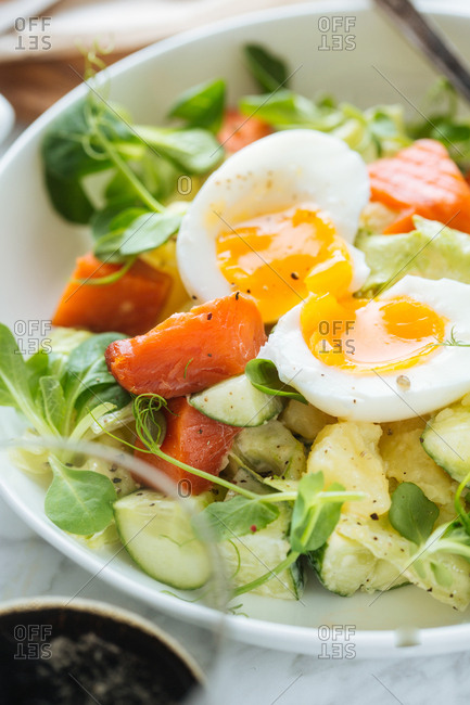 Close-up of salad with egg and smoked salmon