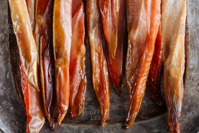 Close-up of strips of smoked fish