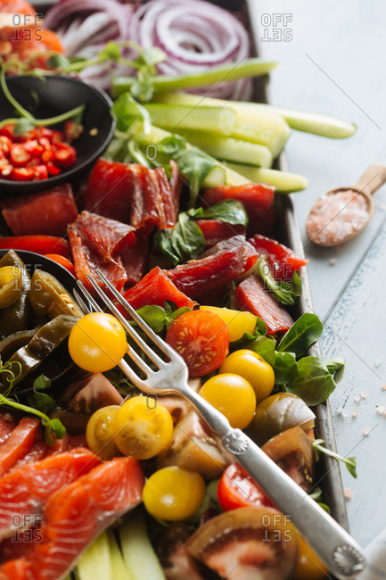 Close-up of arrangement of smoked fish and vegetables