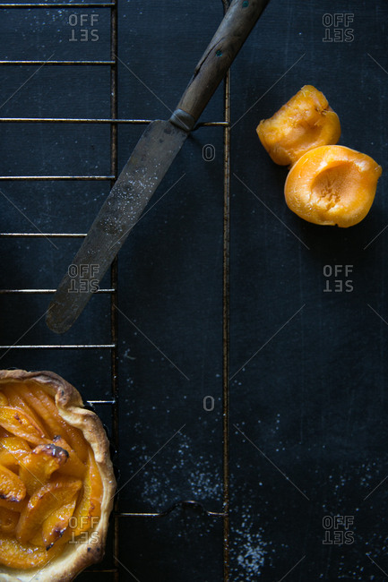 Fresh sliced apricot with baked pie on cooling rack