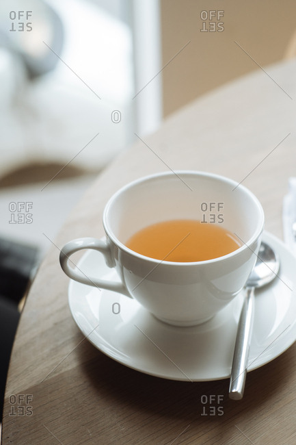 Cup of tea with spoon on table