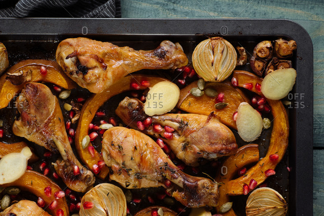 Roasted chicken with onions, squash, garlic and pomegranate seeds