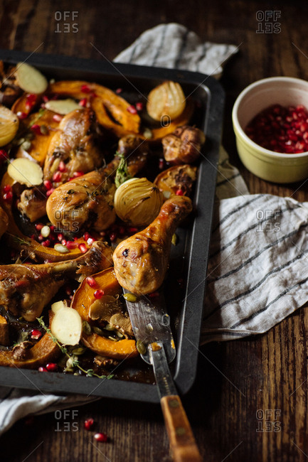 Chicken roasted with squash and pomegranate seeds