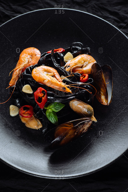 Fresh prawns and mussels served on black pasta