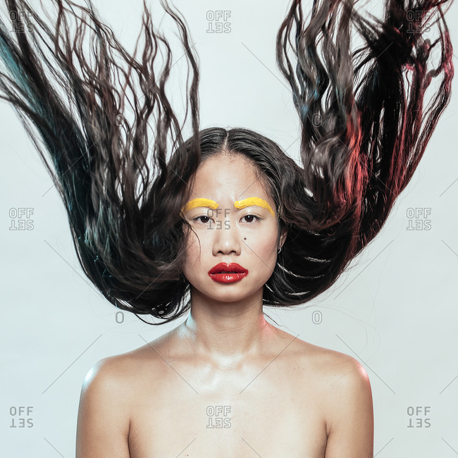 Portrait of an Asian woman with crazy hair and makeup