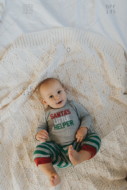 Overhead view of baby wearing Christmas outfit