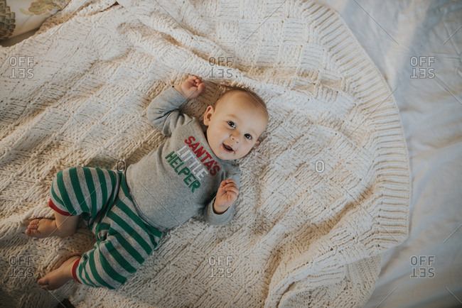 Portrait of a smiling baby wearing Christmas outfit