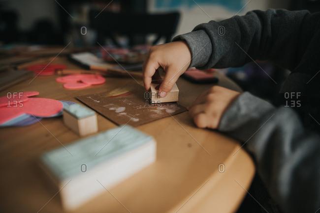 Boy stamping Valentine cards