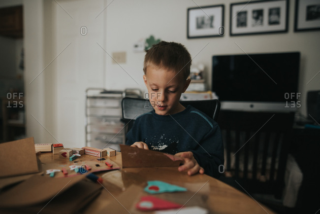 Young boy making Valentine's day cards