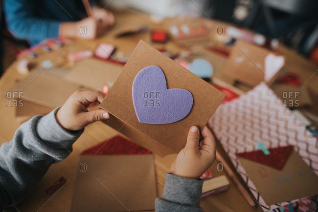 Boy holding a Valentine's day card with heart