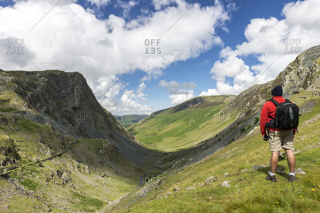 Man overlooking a valley in the Lake District, UK