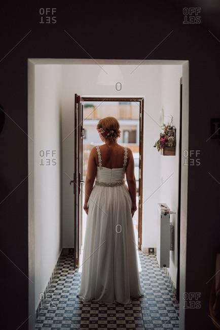 Rear view of bride standing in a doorway